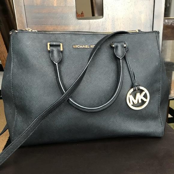 Used MK 2 way-Black with gold accessories bag. M 5a52c2b0a6e3ea1cb0007f37 476377e6742bc